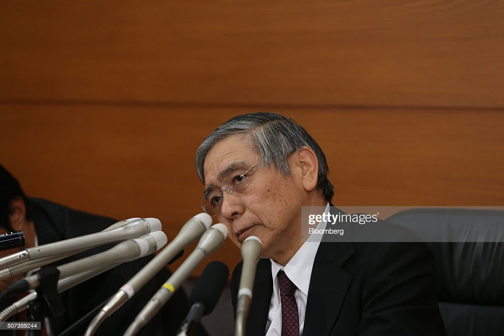 Haruhiko Kuroda, governor of the Bank of Japan (BOJ), listens to a question during a news conference at the central bank's headquarters in Tokyo, Japan, on Friday, Jan. 29, 2016. Kuroda sprung another surprise on investors by adopting a negative interest-rate strategy to spur banks to lend in the face of a weakening economy. Photographer: Tomohiro Ohsumi/Bloomberg via Getty Images