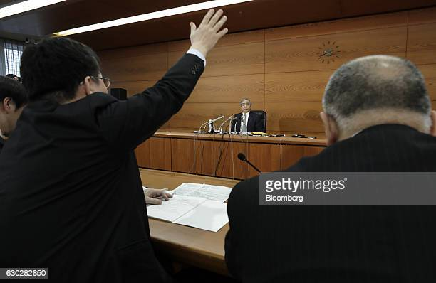 Haruhiko Kuroda governor of the Bank of Japan looks on as a reporter raises his hand to ask a question during a news conference at the central bank's...