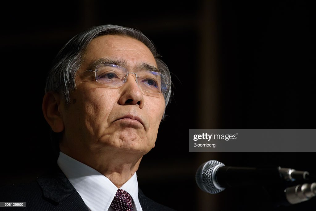 Haruhiko Kuroda, governor of the Bank of Japan (BOJ), pauses at a meeting hosted by Kyodo News in Tokyo, Japan, on Wednesday, February 3, 2016. Kuroda, in his first public speech after the central bank unexpectedly decided on Jan. 29 to adopt a negative interest rate strategy, said that the BOJ will take additional easing measures if needed. Photographer: Akio Kon/Bloomberg via Getty Images