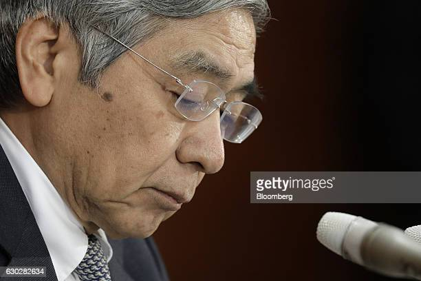 Haruhiko Kuroda governor of the Bank of Japan pauses during a news conference at the central bank's headquarters in Tokyo Japan on Tuesday Dec 20...