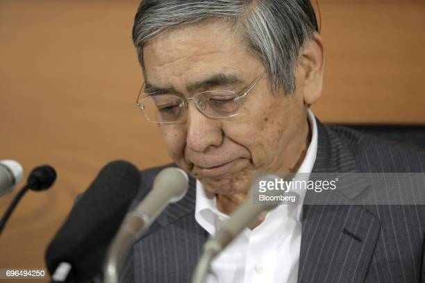 Haruhiko Kuroda governor of the Bank of Japan pauses during a news conference at the central bank's headquarters in Tokyo Japan on Friday June 16...