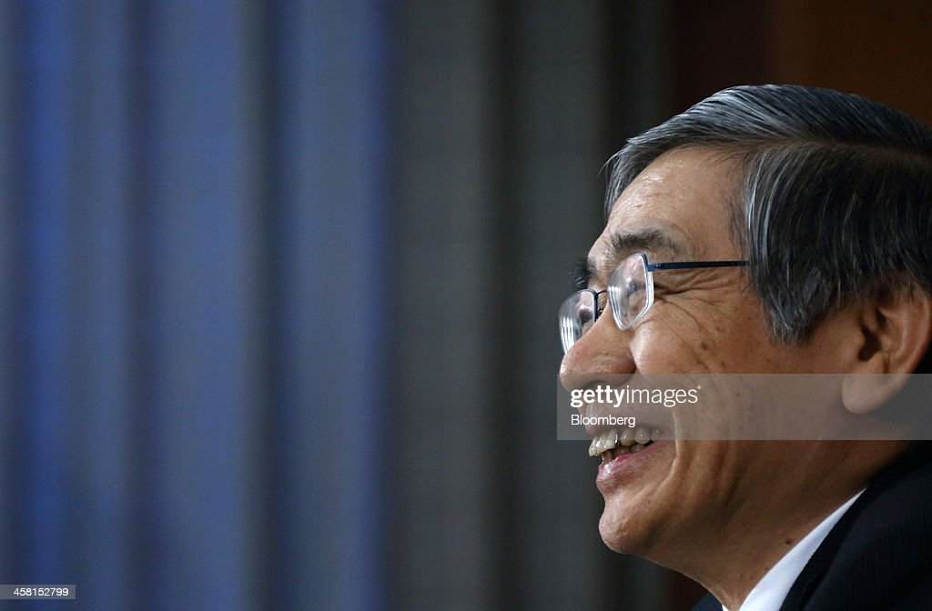 <a gi-track='captionPersonalityLinkClicked' href=/galleries/search?phrase=Haruhiko+Kuroda&family=editorial&specificpeople=649295 ng-click='$event.stopPropagation()'>Haruhiko Kuroda</a>, governor of the Bank of Japan, smiles as he speaks during a news conference at the central bank's headquarters in Tokyo, Japan, on Friday, Dec. 20, 2013. The Bank of Japan maintained its record easing, after a U.S. Federal Reserve decision to taper policy helped weaken the yen to a five-year low against the dollar. Photographer: Tomohiro Ohsumi/Bloomberg via Getty Images