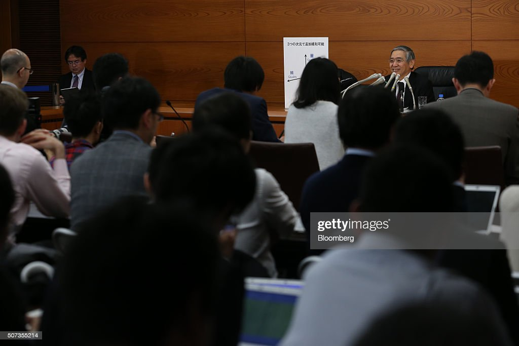 Haruhiko Kuroda, governor of the Bank of Japan (BOJ), smiles during a news conference at the central bank's headquarters in Tokyo, Japan, on Friday, Jan. 29, 2016. Kuroda sprung another surprise on investors by adopting a negative interest-rate strategy to spur banks to lend in the face of a weakening economy. Photographer: Tomohiro Ohsumi/Bloomberg via Getty Images