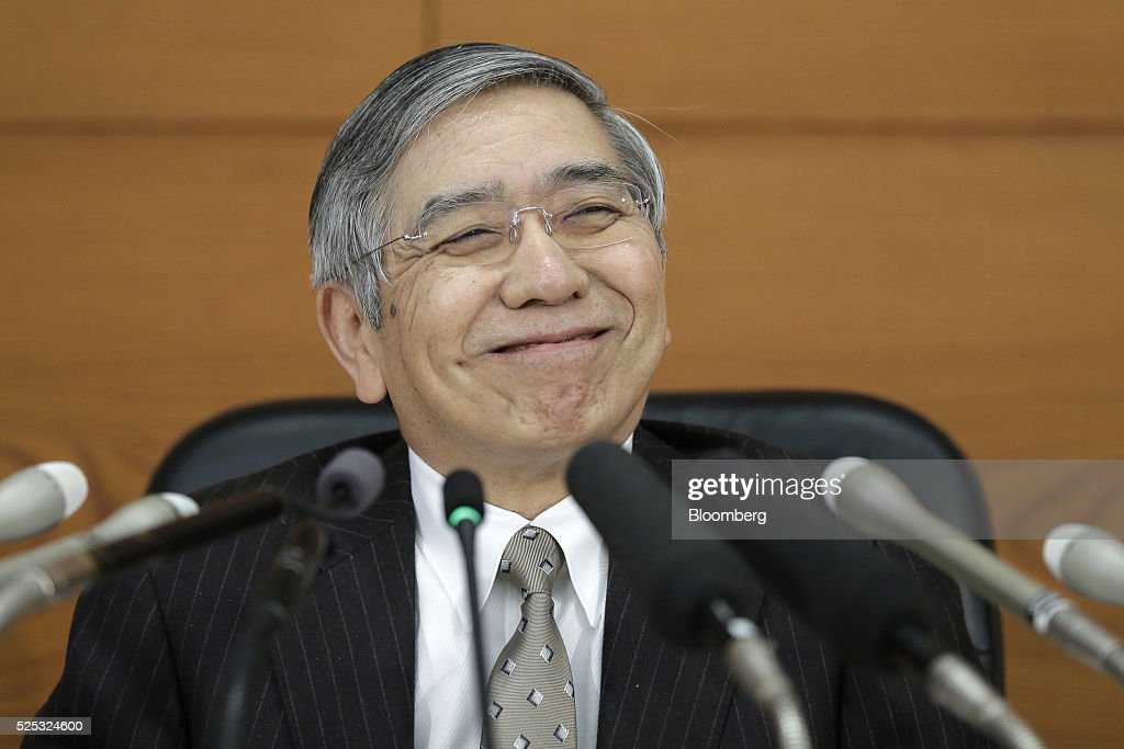 Haruhiko Kuroda, governor of the Bank of Japan (BOJ), smiles during a news conference at the central bank's headquarters in Tokyo, Japan, on Thursday, April 28, 2016. The BOJ held off on expanding monetary stimulus, as Kuroda and his colleagues opted to take more time to assess the impact of negative interest rates. Photographer: Kiyoshi Ota/Bloomberg via Getty Images