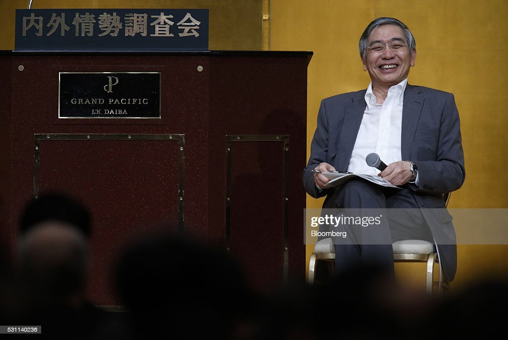 Haruhiko Kuroda, governor of the Bank of Japan (BOJ), smiles during a seminar in Tokyo, Japan, on Thursday, May 13, 2016. The Bank of Japan's surprise decision to charge lenders for some of their reserves has made banks the worst performers on the Tokyo Stock Exchange this year and led to criticism from bank executives and analysts. Photographer: Tomohiro Ohsumi/Bloomberg via Getty Images