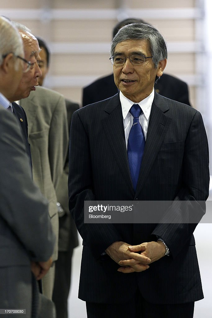 Haruhiko Kuroda, governor of the Bank of Japan, smiles during a tour of a refrigerated warehouse operated by Taiko Suisan Co. in Ishinomaki, Miyagi Prefecture, Japan, on Sunday, June 16, 2013. Kuroda said that the central bank will help support reconstruction of areas in Japan ravaged by the March 2011 earthquake and tsunami. Photographer: Kiyoshi Ota/Bloomberg via Getty Images