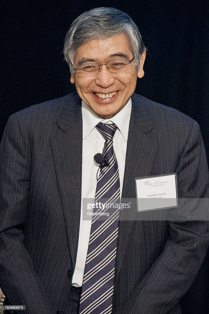 Haruhiko Kuroda, governor of the Bank of Japan (BOJ), smiles during the 2013 Bretton Woods Committee International Council Meeting in Washington, D.C., U.S., on Thursday, Oct. 10, 2013. Kuroda said the bank will do what is necessary to defeat deflation, while declining to discuss specific additional measures it might take. Photographer: Pete Marovich/Bloomberg via Getty Images