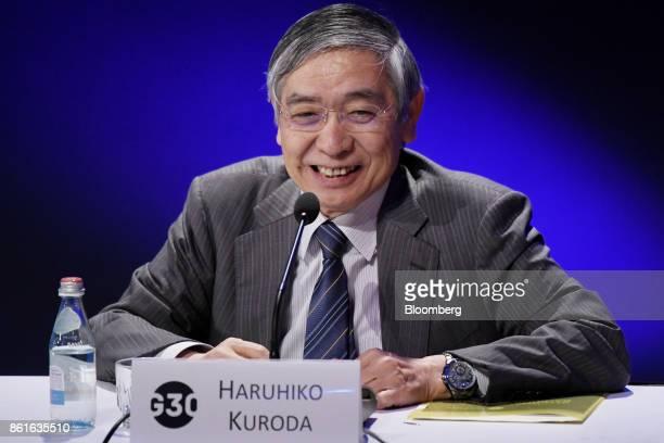 Haruhiko Kuroda governor of the Bank of Japan smiles during the Group of Thirty International Banking Seminar in Washington DC US on Sunday Oct 15...