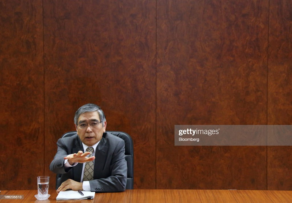 Haruhiko Kuroda, governor of the Bank of Japan (BOJ), speaks during a group interview at the central bank's headquarters in Tokyo, Japan, on Wednesday, April 10, 2013. Kuroda said that the central bank will take all measures necessary to meet a 2 percent inflation target even as he indicated policy adjustments are unlikely every month. Photographer: Tomohiro Ohsumi/Bloomberg via Getty Images