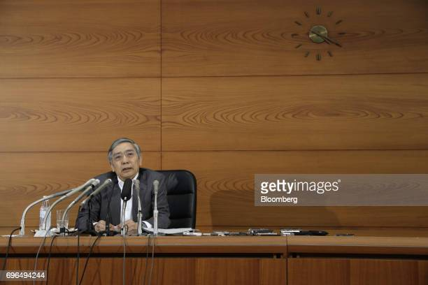 Haruhiko Kuroda governor of the Bank of Japan speaks during a news conference at the central bank's headquarters in Tokyo Japan on Friday June 16...