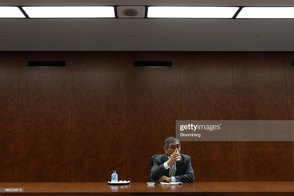 Haruhiko Kuroda, governor of the Bank of Japan (BOJ), takes a drink of water during a group interview at the central bank's headquarters in Tokyo, Japan, on Wednesday, April 10, 2013. Kuroda said that the central bank will take all measures necessary to meet a 2 percent inflation target even as he indicated policy adjustments are unlikely every month. Photographer: Tomohiro Ohsumi/Bloomberg via Getty Images