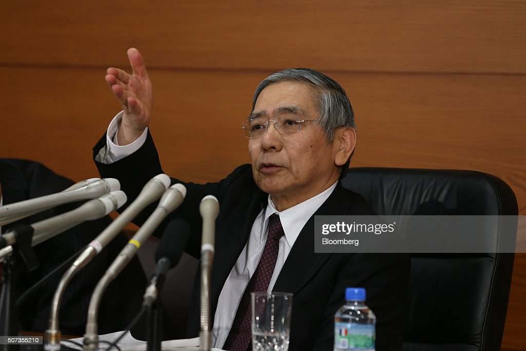 Haruhiko Kuroda, governor of the Bank of Japan (BOJ), takes a question during a news conference at the central bank's headquarters in Tokyo, Japan, on Friday, Jan. 29, 2016. Kuroda sprung another surprise on investors by adopting a negative interest-rate strategy to spur banks to lend in the face of a weakening economy. Photographer: Tomohiro Ohsumi/Bloomberg via Getty Images