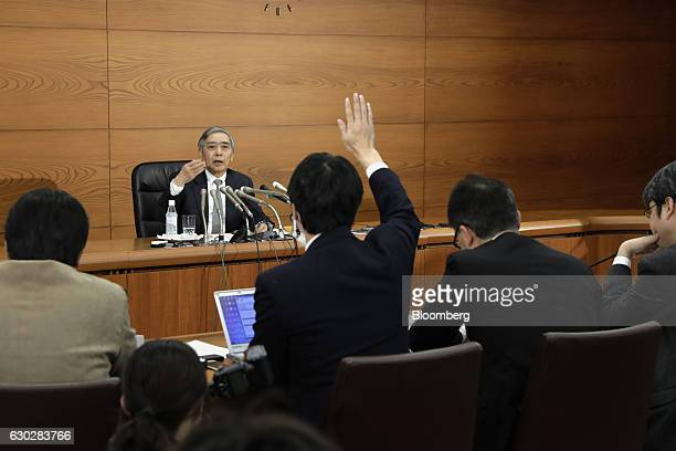 Haruhiko Kuroda governor of the Bank of Japan takes a question during a news conference at the central bank's headquarters in Tokyo Japan on Tuesday...