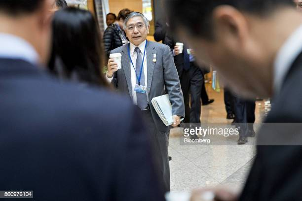 Haruhiko Kuroda governor of the Bank of Japan walks to a Group of 20 finance ministers and central bank governors meeting on the sidelines of the...
