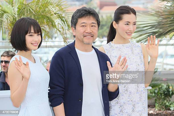 Haruka Ayase director Hirokazu Koreeda and Suzu Hirose attends the 'Notre Petite Soeur' photocall during the 68th annual Cannes Film Festival on May...