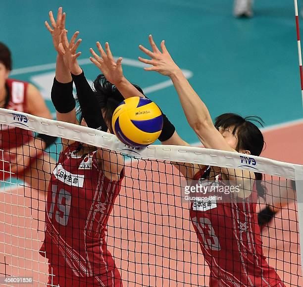 Haruka Miyashita and Risa Shinnabe of Japan blocking during the FIVB Women's World Championship pool D match between Cuba and Japan on September 25...