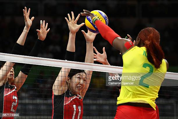 Haruka Miyashita of Japan and Erika Araki of Japan defend the net during the Women's Preliminary Pool A match between Japan and Cameroon on Day 3 of...