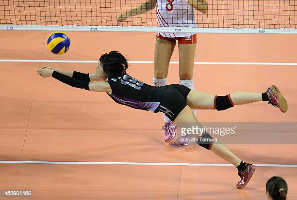 Haruka Miyashita of Japan receives the ball against Turkey during the FIVB World Grand Prix Final group one match between Japan and Turkey on August...