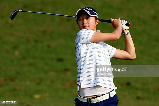 Haruka Morita of Japan plays on the 2nd hole during day two stroke play of the Queen Sirikit Cup of Golf at the Saujana Golf and Country Club on...