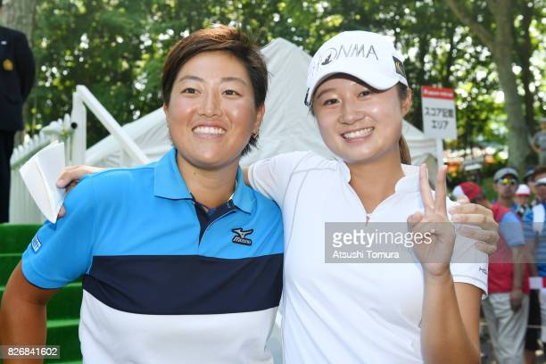Haruka Morita of Japan pose with Haruka Kudo of Japan after winning the meiji Cup 2017 at the Sapporo Kokusai Country Club Shimamatsu Course on...