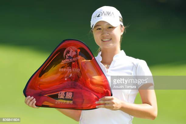 Haruka Morita of Japan poses with the trophy after winning the meiji Cup 2017 at the Sapporo Kokusai Country Club Shimamatsu Course on August 6 2017...
