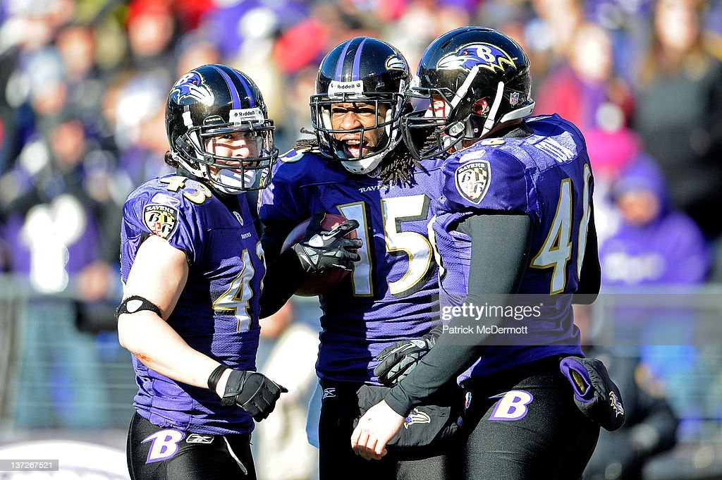 Haruki Nakamura #43, LaQuan Williams #15 and Morgan Cox #46 of the Baltimore Ravens celebrate on the one-yard line during the second quarter of the AFC Divisional playoff game at M&T Bank Stadium on January 15, 2012 in Baltimore, Maryland. Baltimore won 20-13 in regulation.