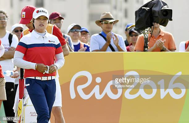 Harukyo Nomura of Japan prepares for a tee shot on the eighth hole during the final round of the women's golf tournament at the Rio de Janeiro...