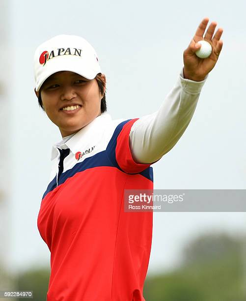 Harukyo Nomura of Japan reacts after finishing nine under on the 18th green during the Women's Golf Final on Day 15 of the Rio 2016 Olympic Games at...