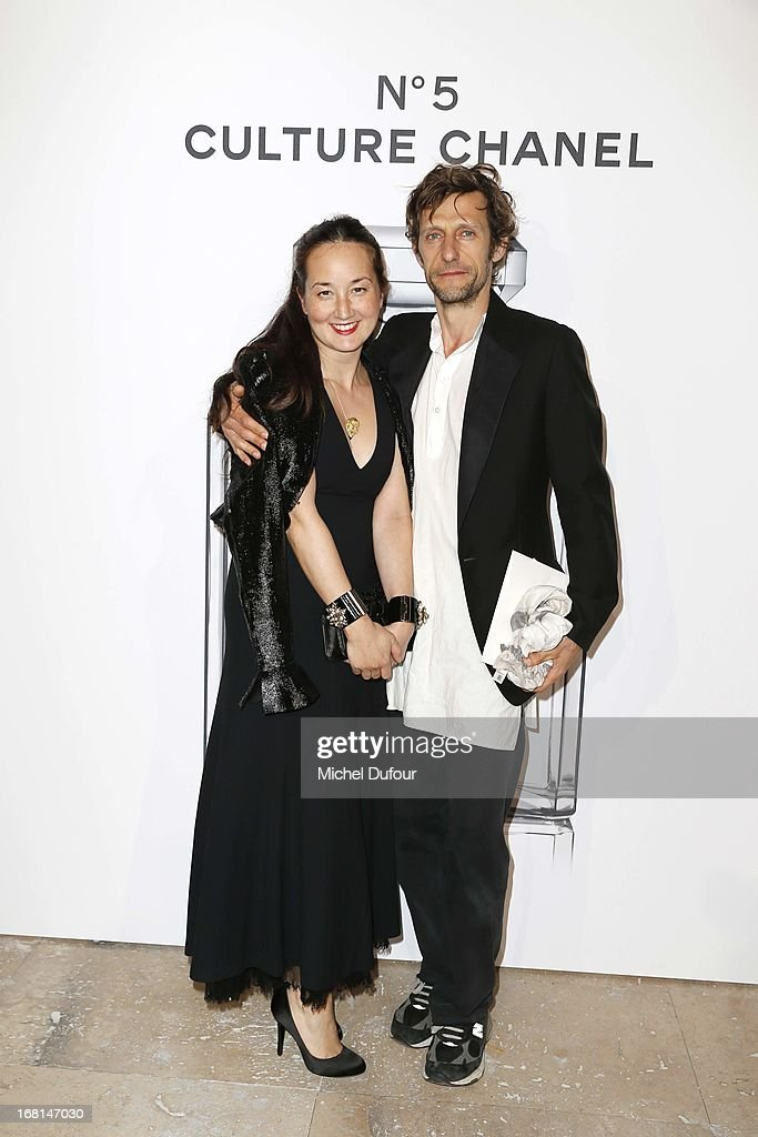 Harumi Klossowska and husband Benoit Peverelli attend the 'No5 Culture Chanel' Exhibition - Photocall at Palais De Tokyo on May 3, 2013 in Paris, France.