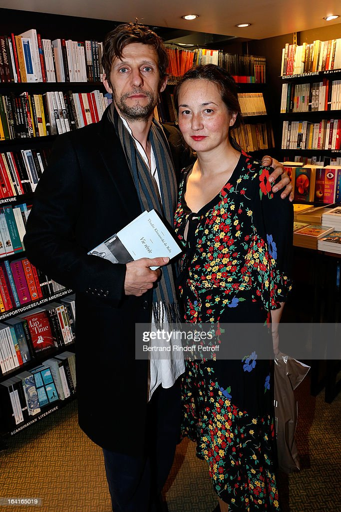 Harumi Klossowska de Rola (R) with her husband Benoit Peverelli (L) attend the book signing of 'Dream Life' (Vie Revee) by Thadee Klossowski De Rola at Galignani Bookstore in Paris, France on March 20, 2013.