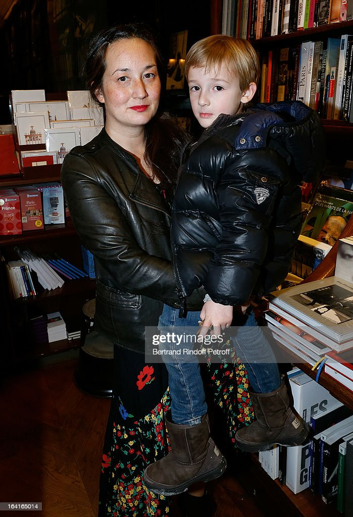 Harumi Klossowska de Rola with her son Sen attend the book signing of 'Dream Life' (Vie Revee) by Thadee Klossowski De Rola at Galignani Bookstore in Paris, France on March 20, 2013.