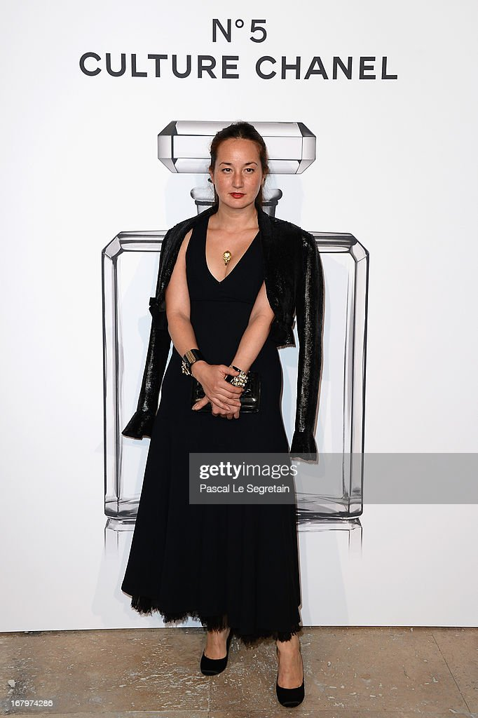 Harumi Klossowska poses during a photocall for 'N°5 Culture Chanel' exhibition at Palais De Tokyo on May 3, 2013 in Paris, France.