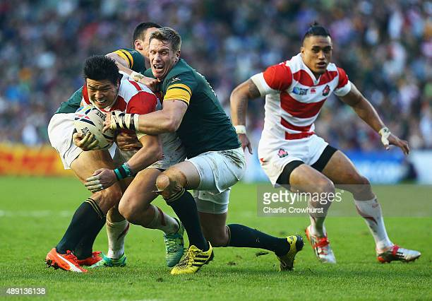Harumichi Tatekawa of Japan is tackled during the 2015 Rugby World Cup Pool B match between South Africa and Japan at the Brighton Community Stadium...