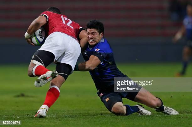 Harumichi Tatekawa of Japan tackles Siale Piutau of Tonga during the international match between Japan and Tonga at Stade Ernest Wallon on November...
