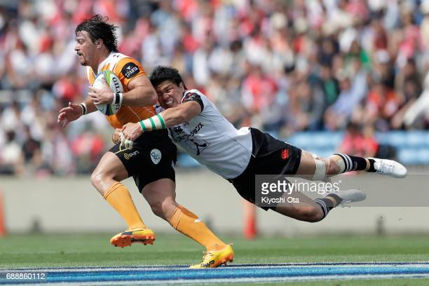 Harumichi Tatekawa of the Sunwolves tackles Clinton Swart of the Cheetahs during the Super Rugby Rd 14 match between Sunwolves and Cheetahs at Prince...
