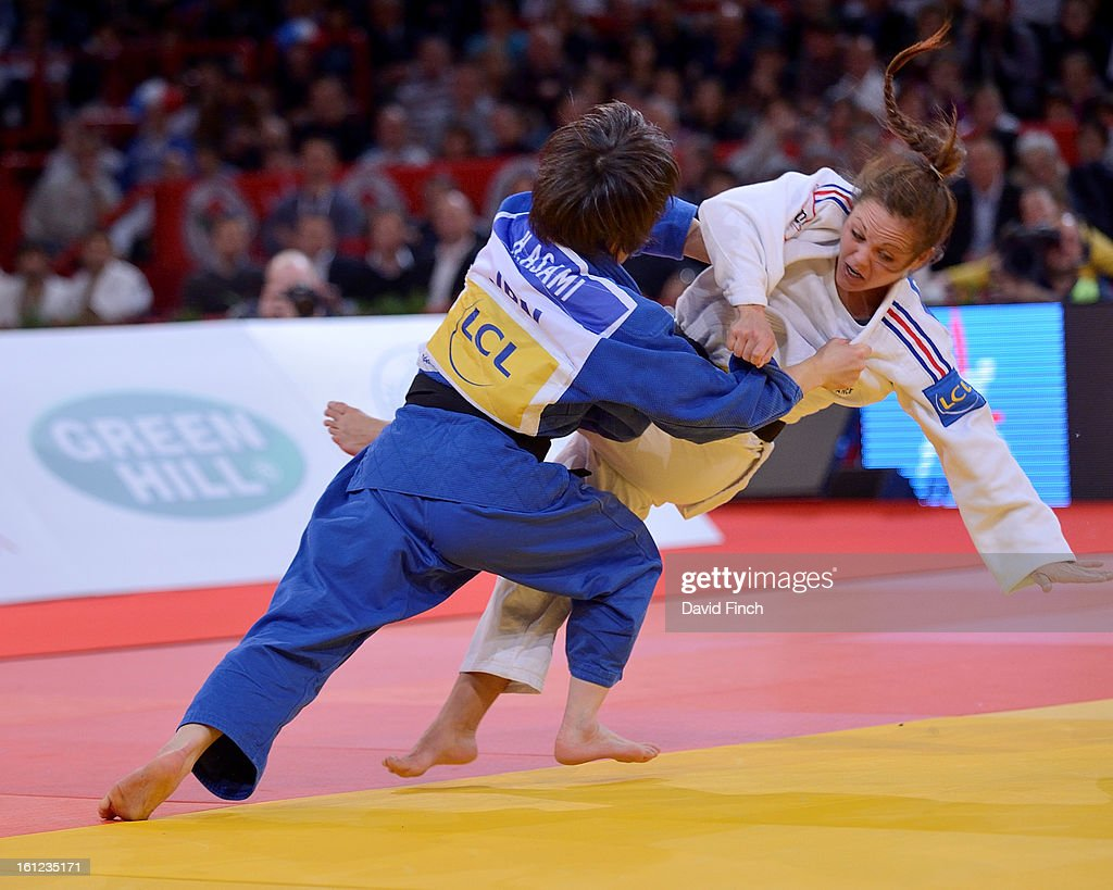 Haruna Asami of Japan (blue) throws Laetitia Payet of France with a leg sweep to win the u48kgs final by a wazari (7 points) during the Paris Grand Slam on day 1 February 09, 2013 at the Palais Omnisports de Paris, Bercy, Paris, France.