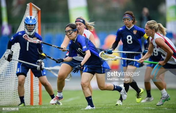 Haruna Kanetou of Japan runs with the ball during the Lacrosse Women's match between Great Britain and Japan of The World Games at Olawka Stadium on...