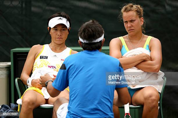 Haruo Nakano instructs Kimiko DateKrumm of Japan and Barbora Zahlavova Strycova of Czech Republic between games against Anabel Medina Garrigues of...