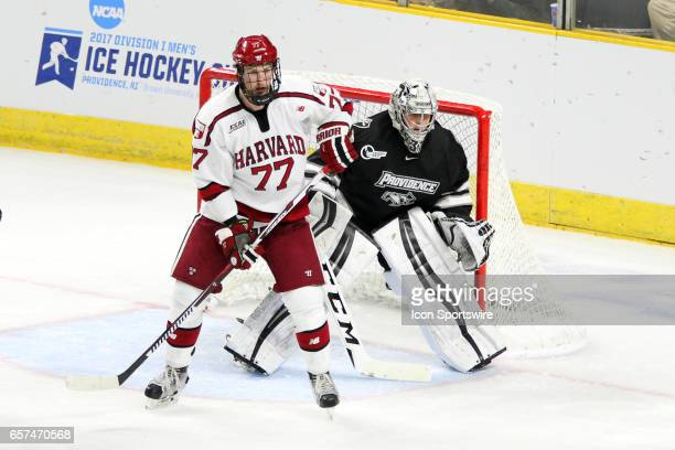 Harvard Crimson forward Lewis ZerterGossage and Providence Friars goalie Hayden Hawkey in action during the second period of the NCAA East Regional...