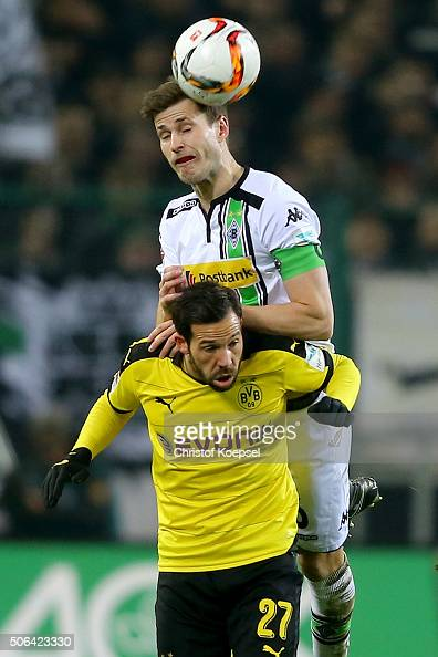 Harvard Nordtveit of Moenchengladbach and Gonzalo Castro of Dortmund go up for a header during the Bundesliga match between Borussia Moenchengladbach...