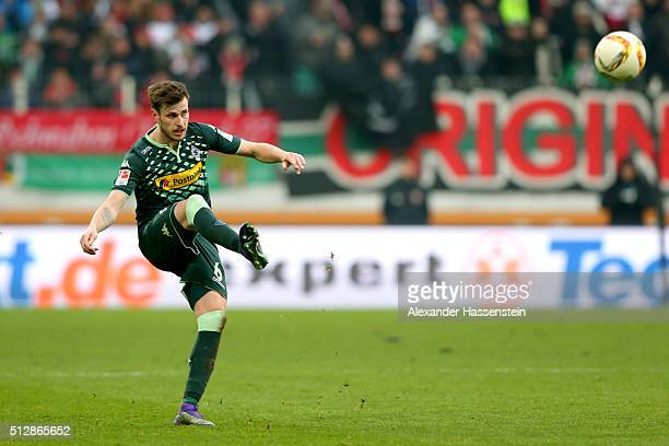 Harvard Nordtveit of Moenchengladbach runs with the ball during the Bundesliga match between FC Augsburg and Borussia Moenchengladbach at WWK Arena...