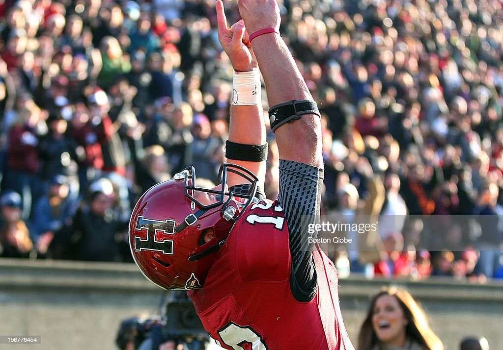 Harvard quarterback Colton Chapple celebrates after he scored a third quarter touchdown, putting Harvard ahead 12-3, as Harvard University hosts Yale University during their annual game, Nov. 17, 2012 at Harvard Stadium.