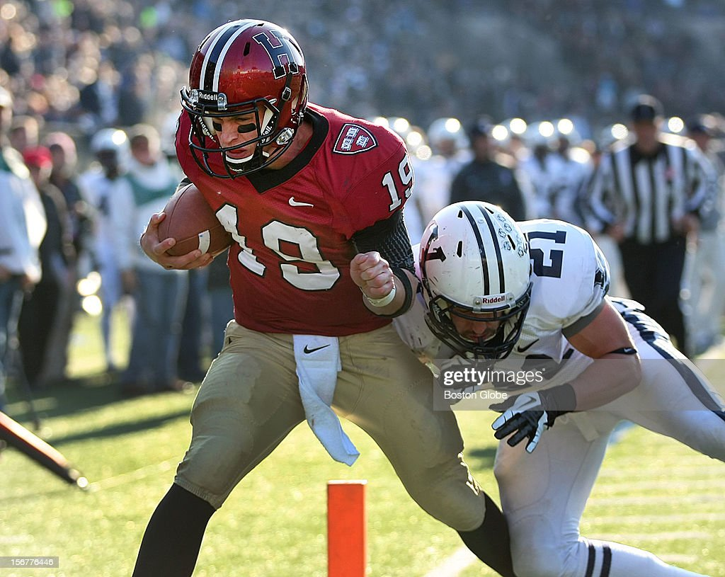 Harvard quarterback Colton Chapple scores a third quarter touchdown putting Harvard ahead 12-3 as Harvard University hosts Yale University during their annual game, Nov. 17, 2012 at Harvard Stadium. Yale's Colin Bibb, right, couldn't catch him in time.