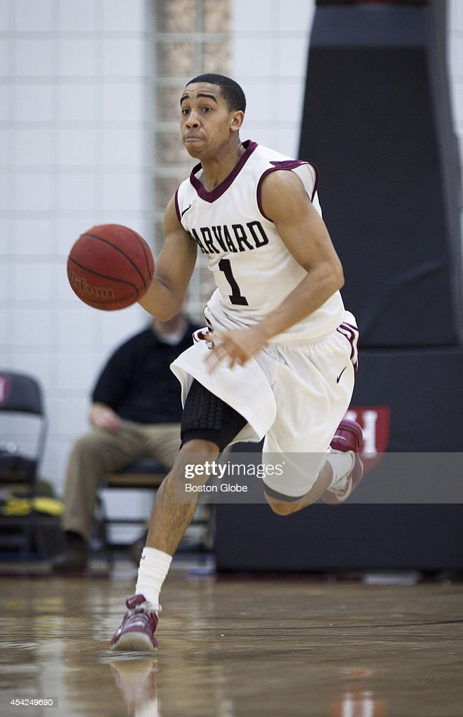 Harvard sophomore Siyani Chambers runs the ball down the court. Harvard and Dartmouth's men's basketball teams faced off at Harvard's Lavietes Pavilion on Saturday, January 11, 2014.