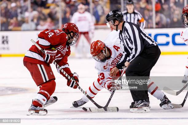 Harvard University Crimson forward Alexander Kerfoot and Boston University Terriers forward Jakob Forsbacka Karlsson face off during the third period...