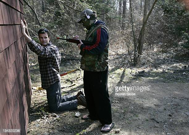 Harvard University graduate student Peter Howard on his knees is mock detained by volunteer Peter O'Connell as part of The Harvard Humanitarian...