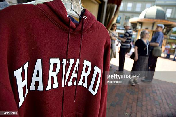 Harvard University logo appears on a sweatshirt on display in Harvard Square in Cambridge Massachusetts US on Friday Sept 4 2009 Community activists...