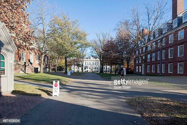 Harvard University police officer walks through an evacuated and closed Harvard Yard following a bomb threat that was made on campus on November 16...