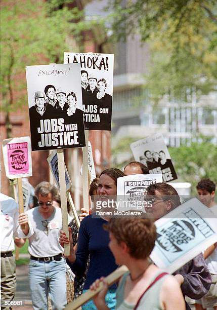 Harvard University students walk a picket line May 3 2001 in Harvard Yard in Cambridge MA A student 'sit in' is in it's sixteenth day with some 30...