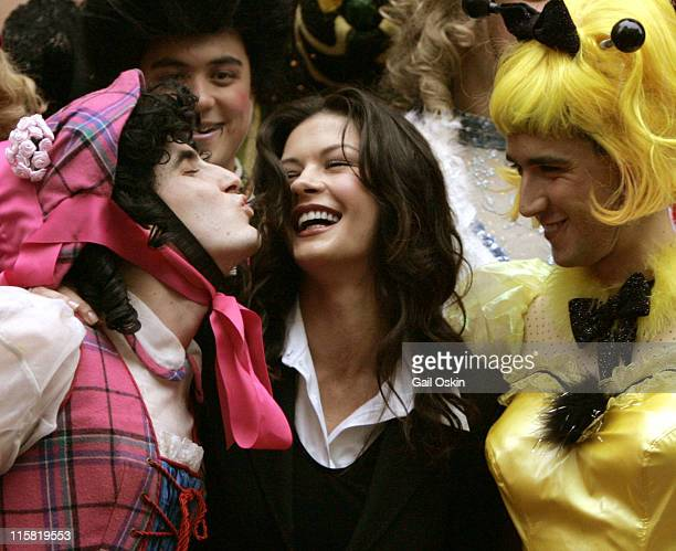 Harvard University's Hasty Pudding Woman of the Year Catherine ZetaJones center is kissed by two Hasty Pudding Theatrical men in drag with Mathew...